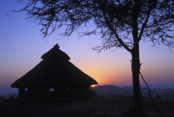 Africa, Ethiopia, Omo river region, Sunset over a traditional Konso hut
