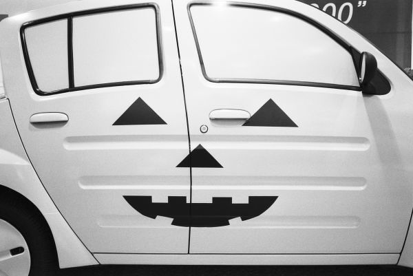 Asia, Japan, Tokyo. Toyota Will, Vi car painted to look like Halloween Pumpkin,. Aoyama
