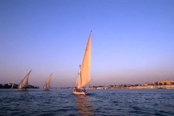 Beautiful sail boats riding along the famous Nile River in Cairo Egypt