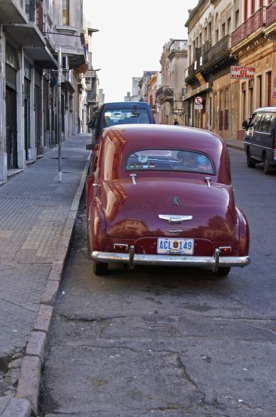 A classic old red Peugeot car parked on a street corner, probably from the 1950s, Montevideo, Uruguay, South America