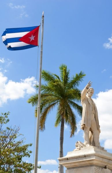 Cuban flag and statue in center of town of Jose Marti hero in CVienfuegos Cuba