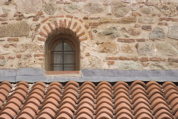 Europe, Greece, Meteora. Tile roof and small window in Grand Meteora Monastery. Credit as