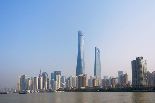 Pudong Skyline Dominated By Shanghai Tower By Huangpu River 19028312