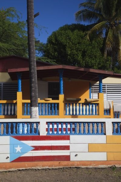 Puerto Rico, South Coast, Guanica, house with Puerto Rican flag mural