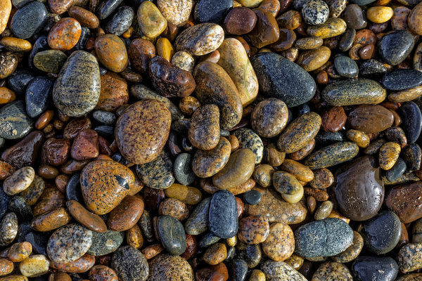 Smooth granite pebbles on beach of Lake Superior, Whitefish Point, Upper Peninsula, Michigan