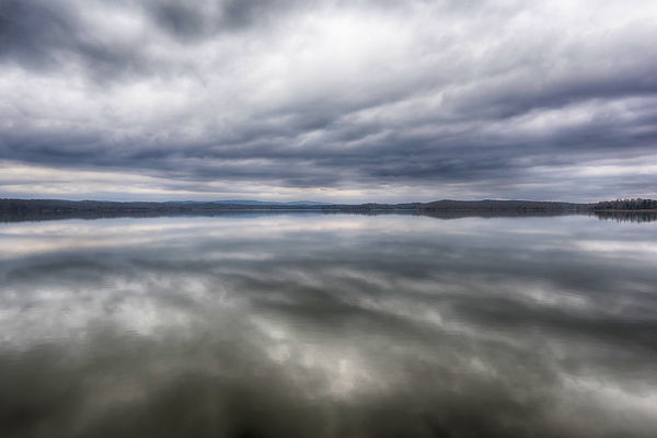 USA, Tennessee. Ten Mile. Calm before the storm. Storm clouds reflected in glass calm lake