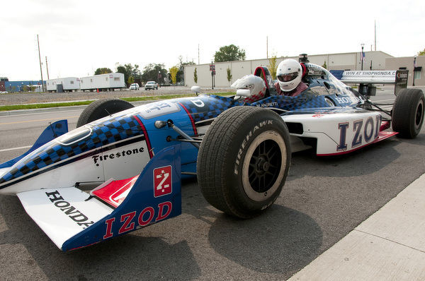 USA, Indiana, Indianapolis Motor Speedway, ride in a street-legal version of an Indy 500 car at Dellara car manufacturing facility by journalist Lee Foster