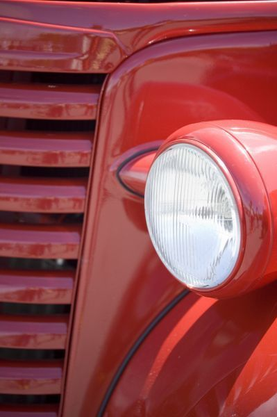 USA, Maine, Owl's Head. Headlight and partial grill of a red antique truck. Credit as: Kathleen Clemons / Jaynes Gallery / Danita Delimont