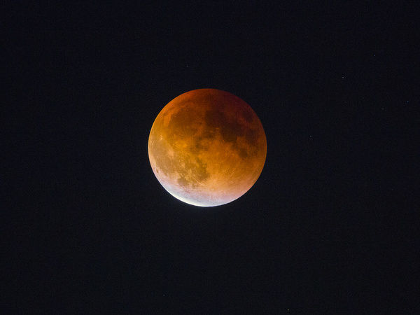 USA, Washington State. Begginning of the end of Blood Moon (lunar eclipse) in Seattle