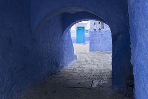 Africa, Morocco. A blue alley and door in the hilltown of Chefchaouen