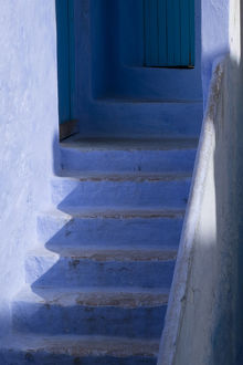 Africa, Morocco, Chefchaouen. Steps leading up into a home