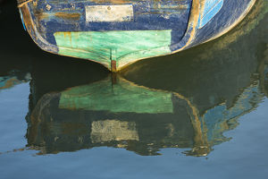 Africa, Morocco, Essouira. An artistic watercolor effect of a wooden boat floating