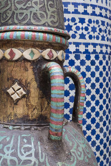 Africa, Morocco, Fes. Vase and pillar details with traditional design in the interior
