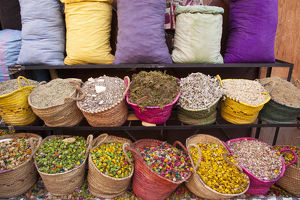 Africa, Morocco, Marrakech. A colorful display of potpourri and herbs for sale at a shop