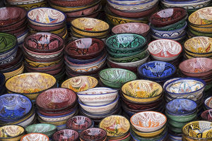 Africa, Morocco, Marrakech. Colorfully painted ceramic bowls for sale in a souk, a shop