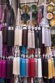 Africa, Morocco, Marrakech. Curtain tie-backs for sale at a market stall in the medina