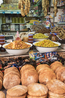 Africa, Morocco, Moulay Idriss. Market stall selling bread, olives, figs and other