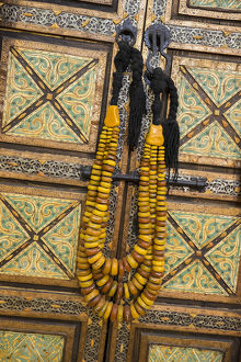 Africa, Morocco, Tinerhir. Traditional necklace of Berber woman hangs on an ornate