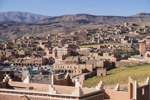 Africa, Morocco. The town of Boulmalne du Dades spills up the hillsides of the Atlas