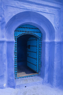 Africa, Morocco. A traditional blue doorway in the hilltown of Chefchaouen