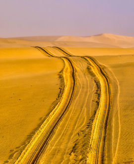 Africa, Namibia, Tire Tracks in the Desert outside Swakopmund