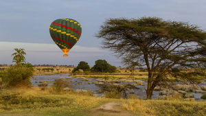 Africa. Tanzania. Hot air balloon crossing the Mara river in Serengeti NP