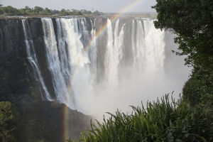 Africa, Zimbabwe, Victoria Falls. Landscape of waterfall and rainbow