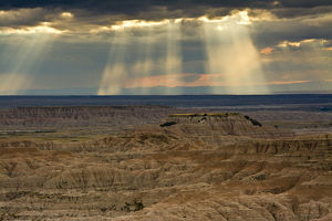 approaching storm and crepuscular rays, sunset, Pinnacles Viewpoint, Badlands National