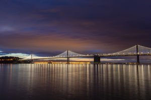 The Bay Bridge reflects at dawn in San Francisco, California, USA