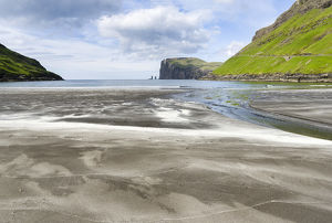 Beach at Tjornuvik. In the background the island Eysturoy with the iconic sea stacks Risin