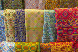Bhutan, Thimphu. Colorful textiles for sale in a shop