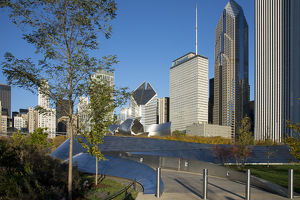 BP Bridge in Millennium Park in Chicago, early morning in autumn, with skyline