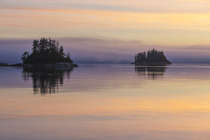 British Columbia. Sunset paints a canvas of pastel hues in Johnstone Strait