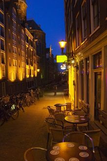 Buildings with 17th or 18th century facade and narrow lane at night, Amsterdam