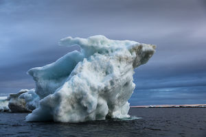 Canada, Nunavut Territory, Repulse Bay, Melting iceberg grounded in Harbour Islands