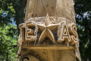 Carved totem pole art with Texas star, Wimberley, Texas, USA, For Editorial Use Only