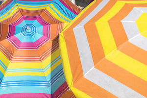 europe/greece/colorful beach umbrellas