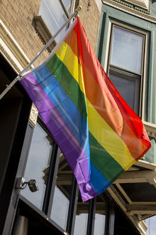 Colorful rainbow flag on Halsted Street in 'Boystown' the gay neighborhood
