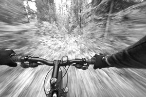 Cruising down a buff section of singletrack trail from the riders perspective near