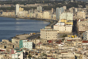 Cuba, Havana. An elevated view of the city skyline showing the bay and Malecon
