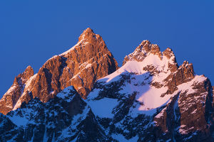 Dawn light on the Grand Teton and Mount Owen in winter, Grand Teton National Park