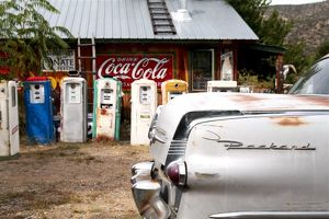 Dixon, New Mexico, United States. Vintage car and gasoline pumps