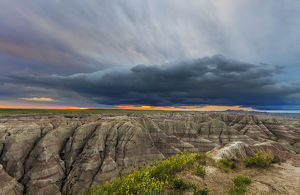 Dramatic storm cloud at sunrise in Badlands National Park, South Dakota, USA