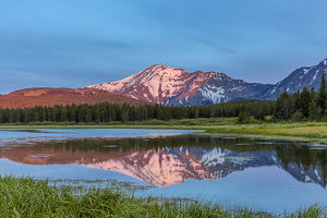 Elk Mountain reflects into Three Bears Lake at Marias Pass in Glacier National Park