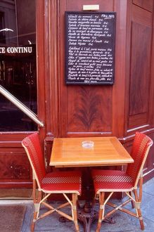 EU, France, Paris. Two chairs in front of a Parisian bistro