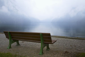 Europe, Germany, Lake Konigssee. Bench and lake in fog