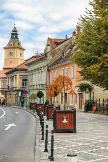Europe, Romania, Brasov, Street scene from Council Square. Clock tower