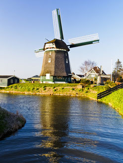 Europe;Netherlands;Nord Holland;Windmill along canal of Nord Holland