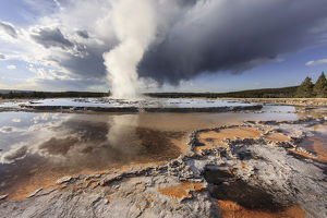 Great Fountain Geyser and storm cloud, Yellowstone National Park, Wyoming/Montana