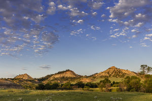Late day light on badlands and ranch pastures near Miles City, Montana, USA